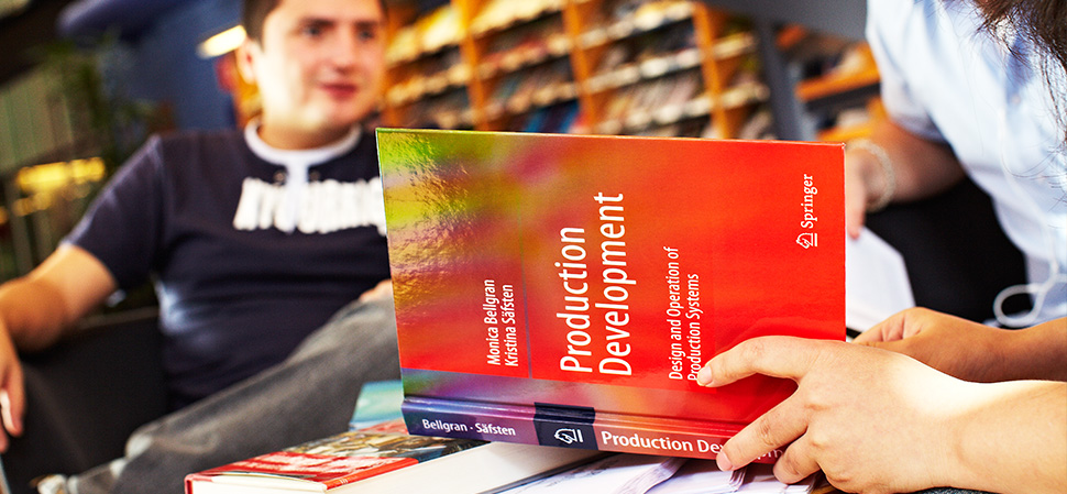 Student reading course literature in the library