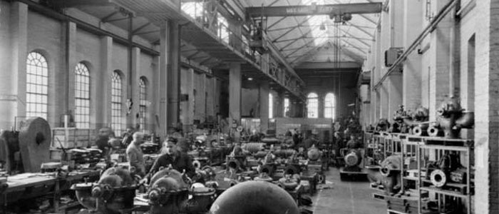 Old monochrome image of the foundry building being used as a workshop.