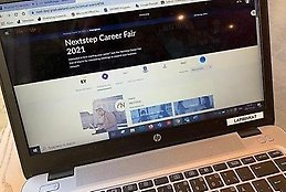 A laptop open with startpage of Nextstep digital career fair on the screen.
